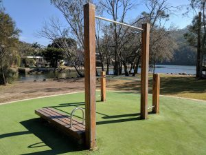 Outdoor Gym featuring dip bars, pull up bar and ab bench