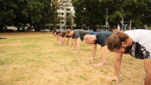 Students holding a plank