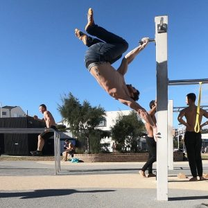 Nathan Leith demonstrates calisthenics chamber hold at Bondi