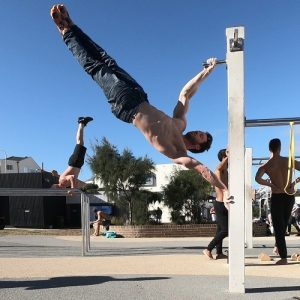 Nathan Leith demonstrates calisthenics 45 degree hold at Bondi