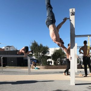 Nathan Leith demonstrates calisthenics vertical hold at Bondi