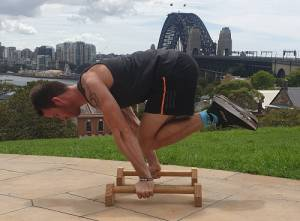 Nathan performing a tuck planche push-up